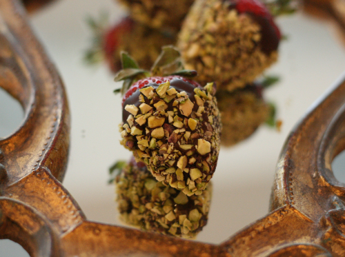 Chocolate-dipped strawberries with chopped pistachios